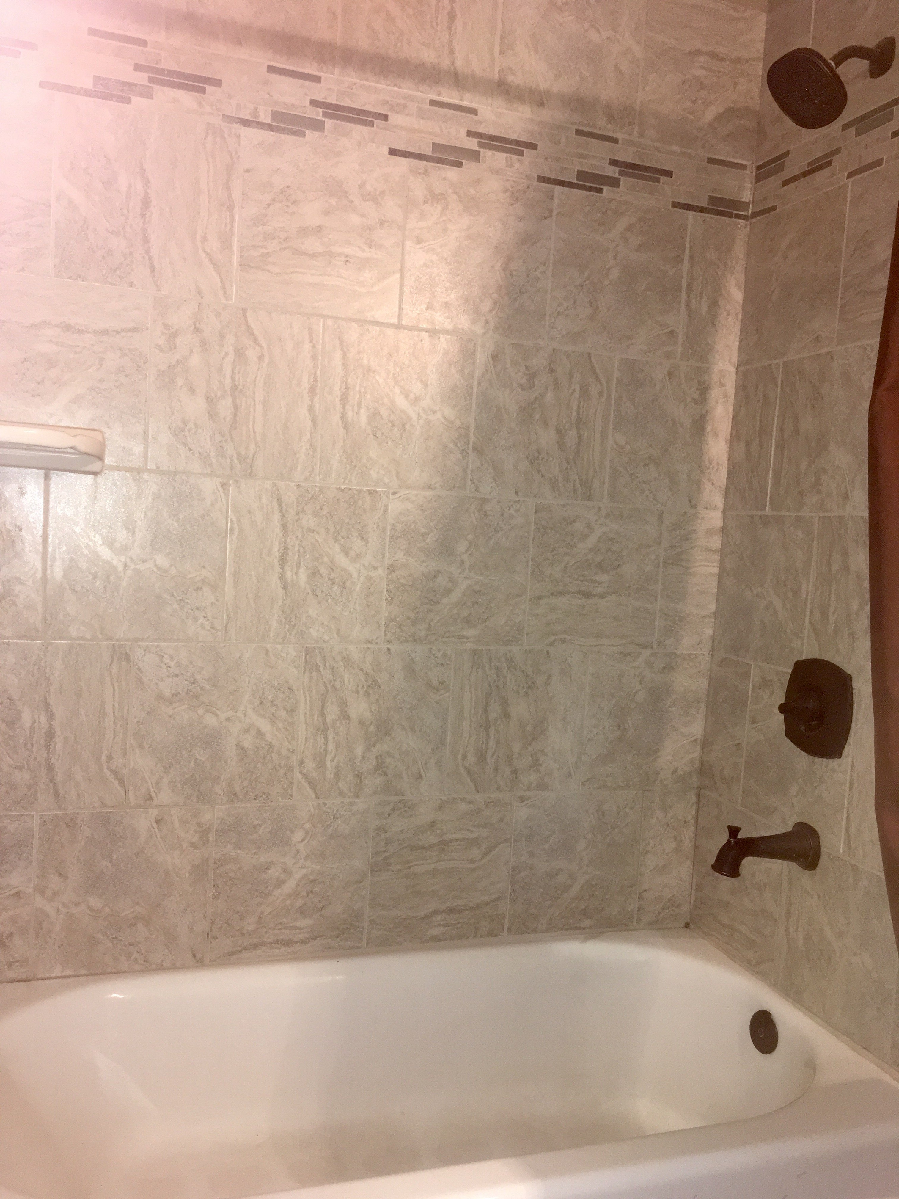 Brand new bathroom tub tiles installed by A & G Painting in Anchorage, AK