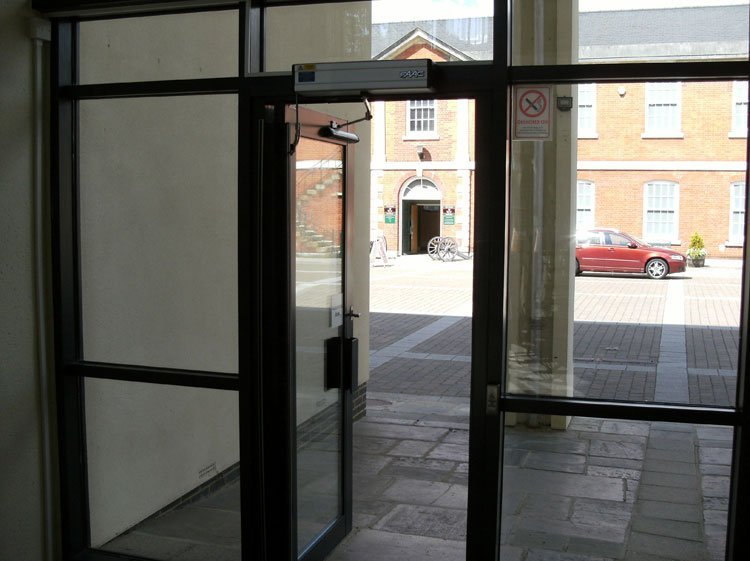 Automated commercial entrance door