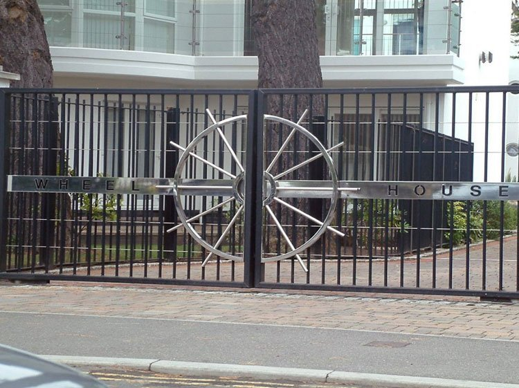 Sliding metal entrance gates