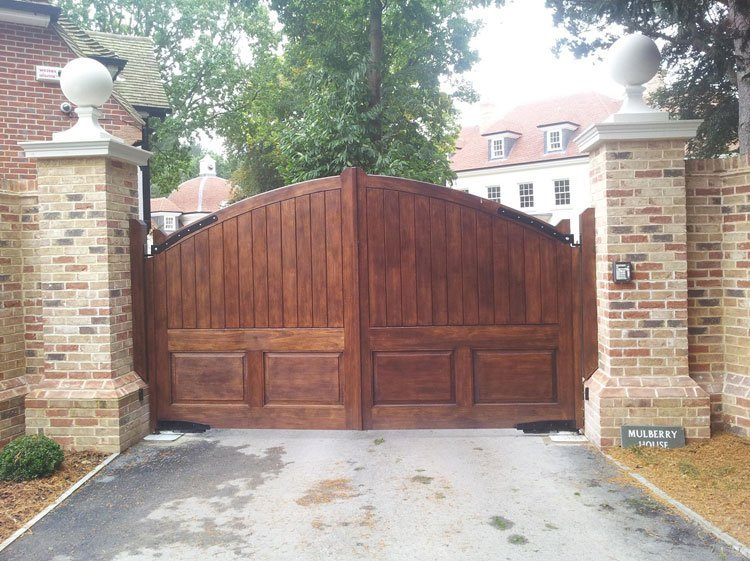 Automated solid wood entrance gates