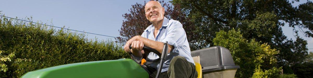 lens trading co man on mower