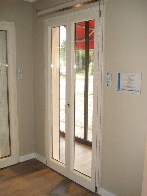porta interno in legno esterno in alluminio o bronzo
