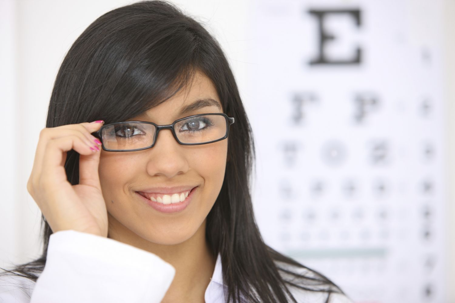A stylish woman is wearing glasses in our eye clinic in Kapaa, HI