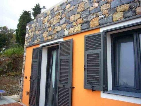 realizzazione muro in pietra e verniciatura