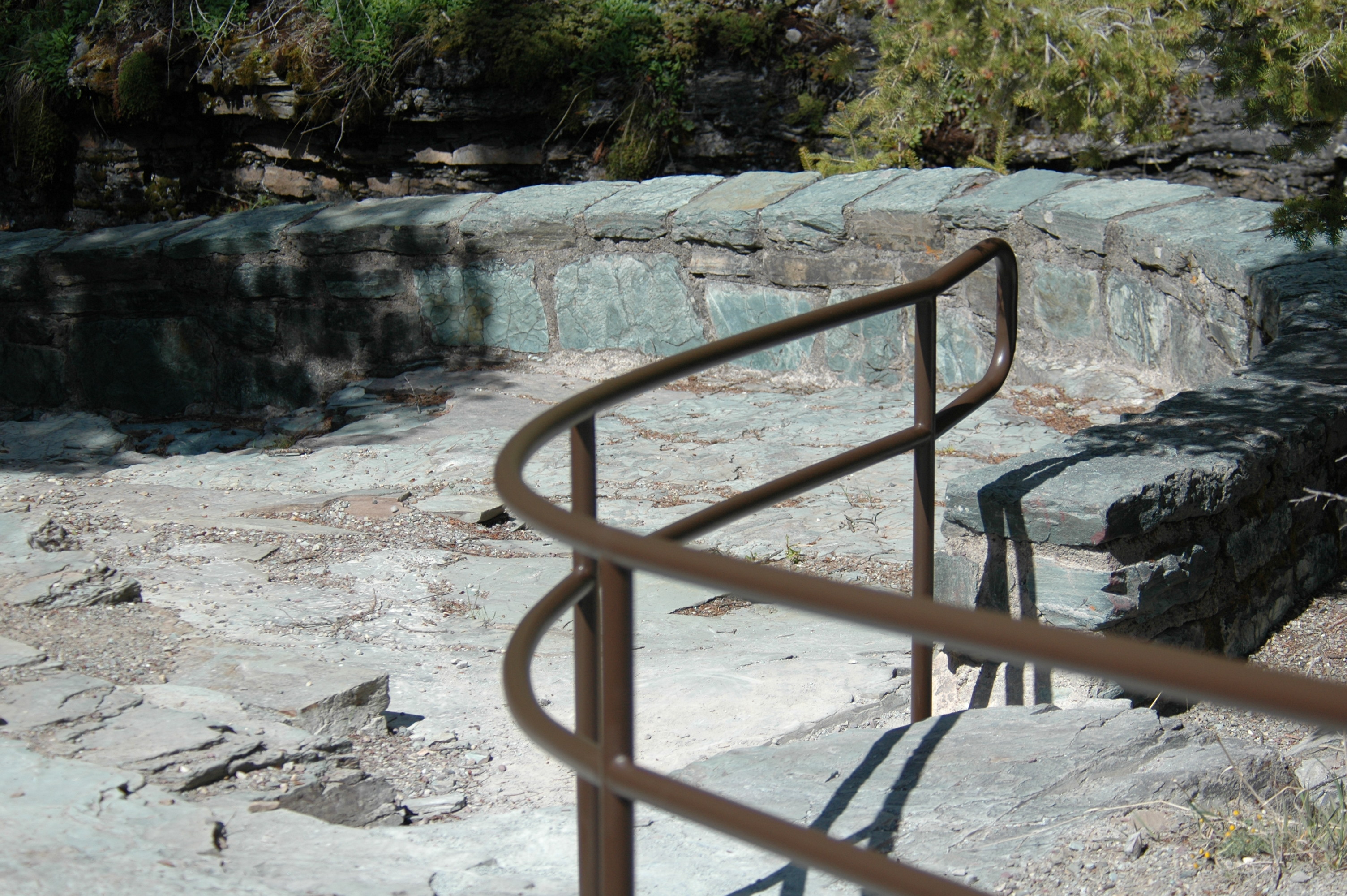 Stone steps and iron handrail