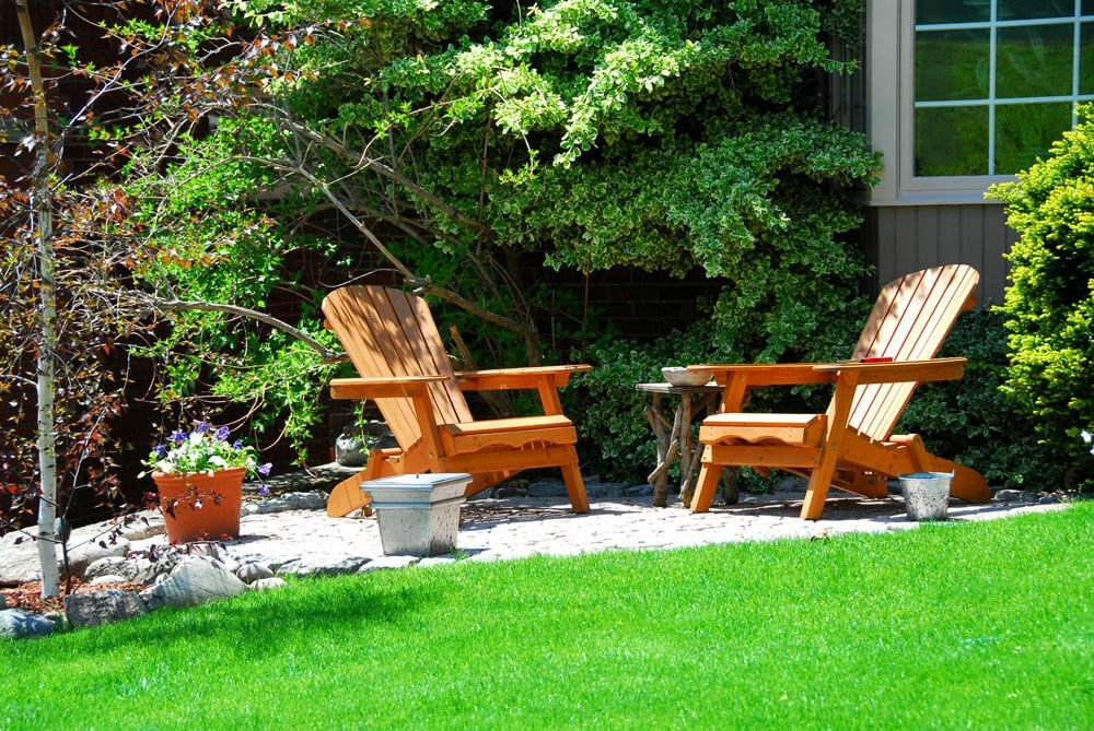 two orange wooden chairs in the garden