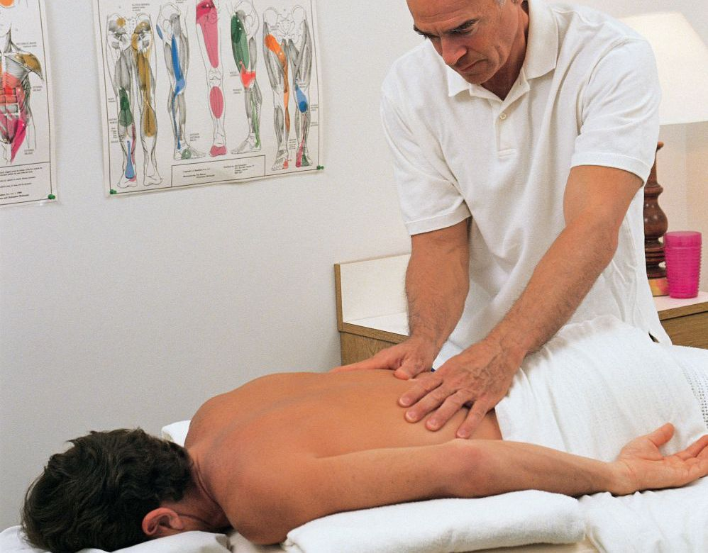 Man receives treatment in a chiropractic center in High Point, NC