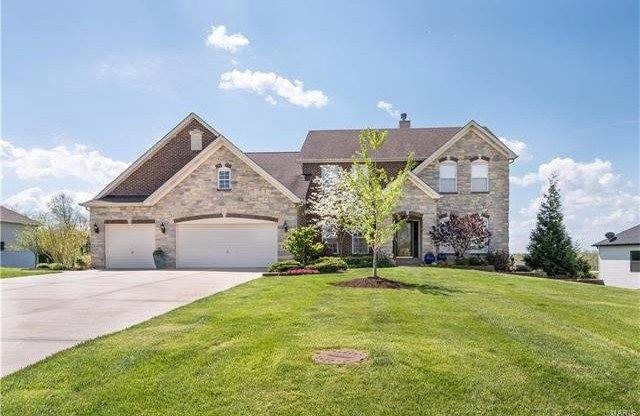 Remarkable Executive 1 1/2 Story Home - exterior view