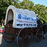 Promoting the company on  horse cart side view