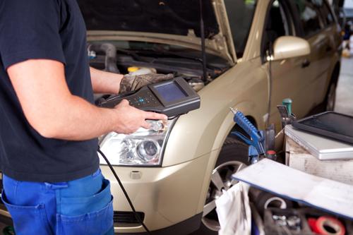 Professional servicing car in Lorain, O H