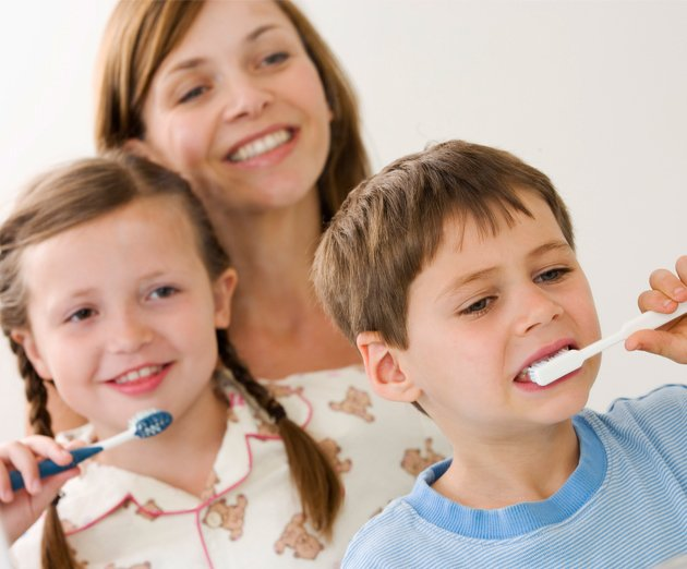 dental vision mother watching children brush teenth