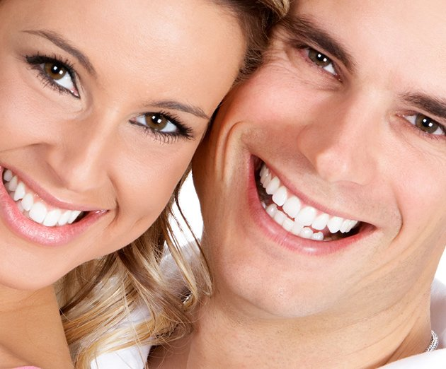 dental vision smiling couple showing white teeth