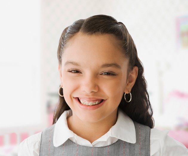 dental vision young girl smiling with braces