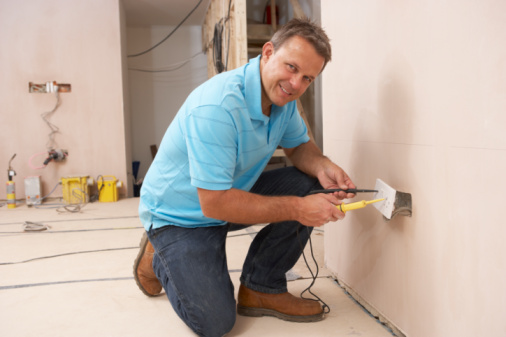A man performing electrical services in La Crosse, WI