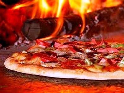 Pizza cooked in the oven - Pizzeria LA STALLA
