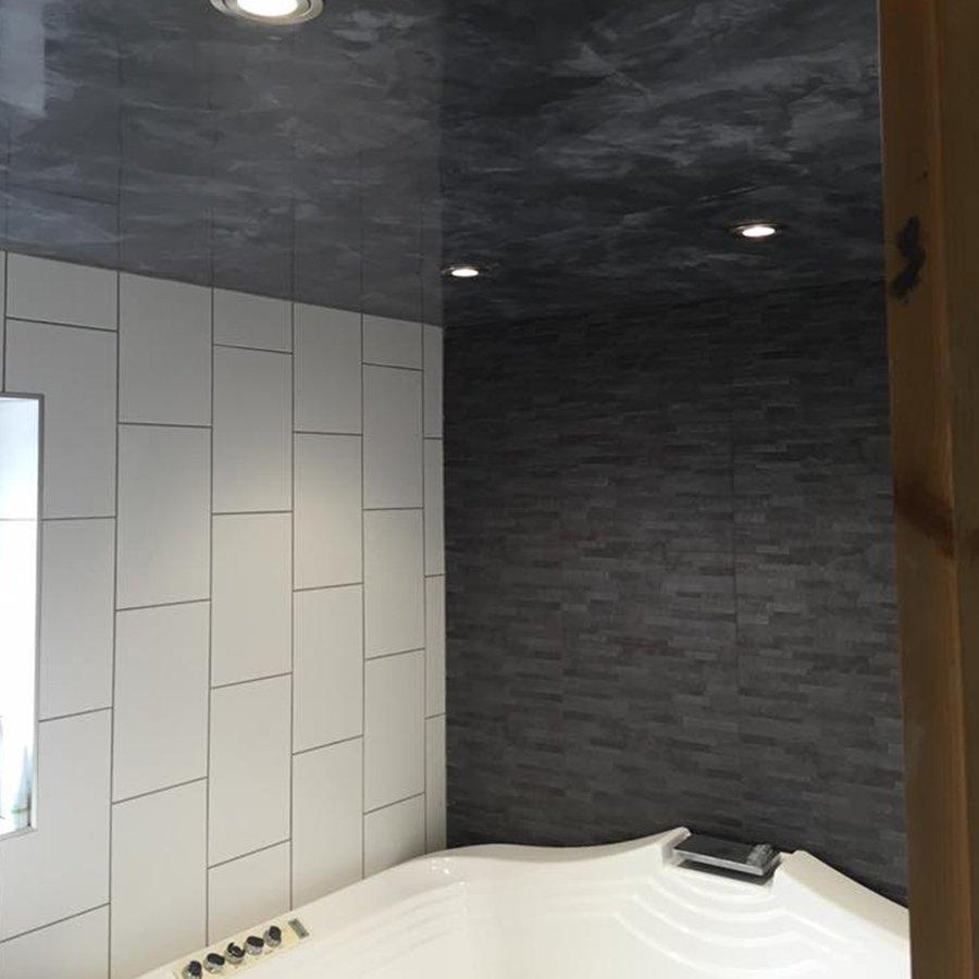 nice designed bathroom in black and white tile