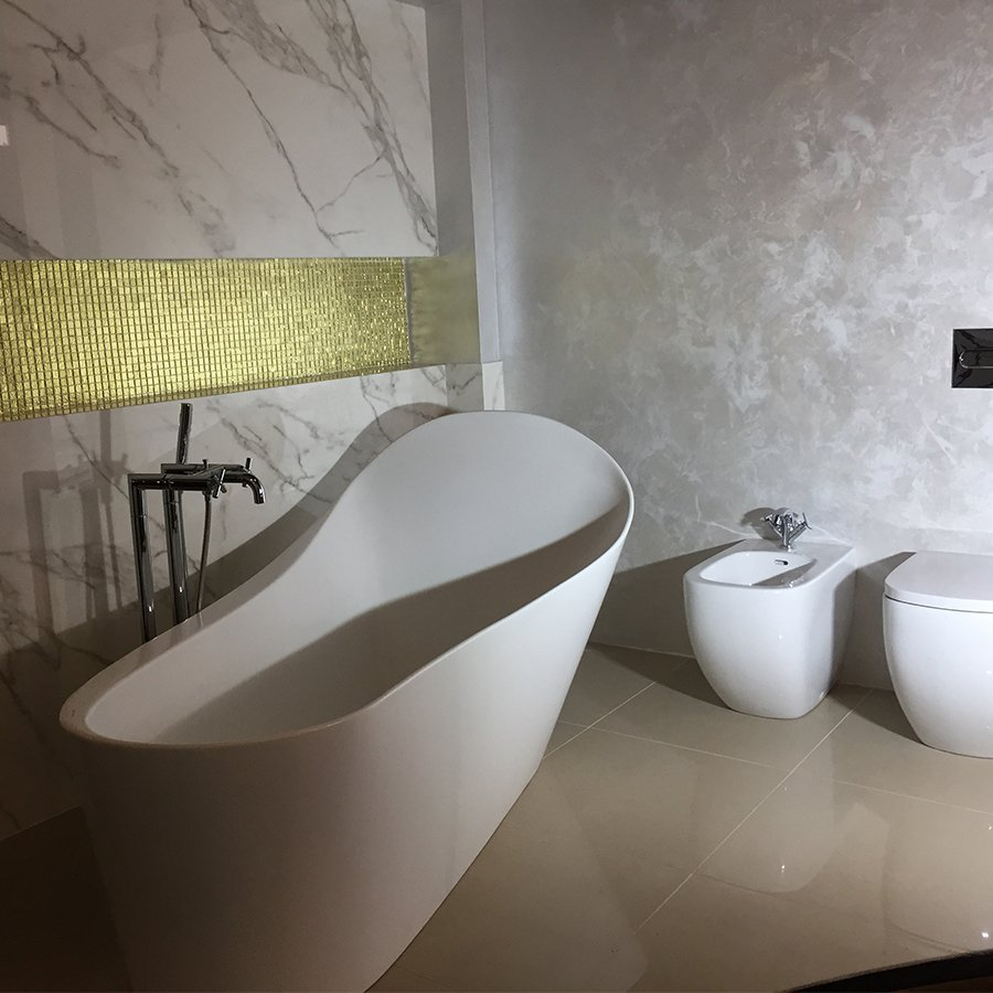 stylish bathroom with curved tub and toilet