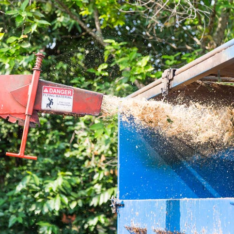 Wood chipping machine in action