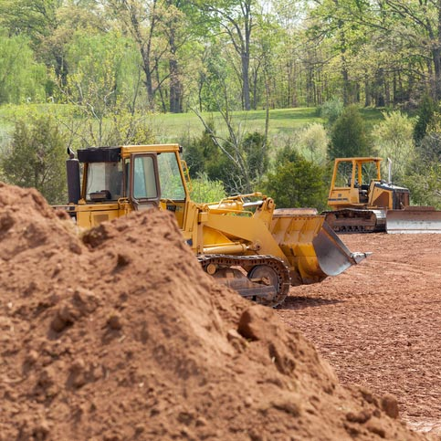 Heavy equipment clearing land