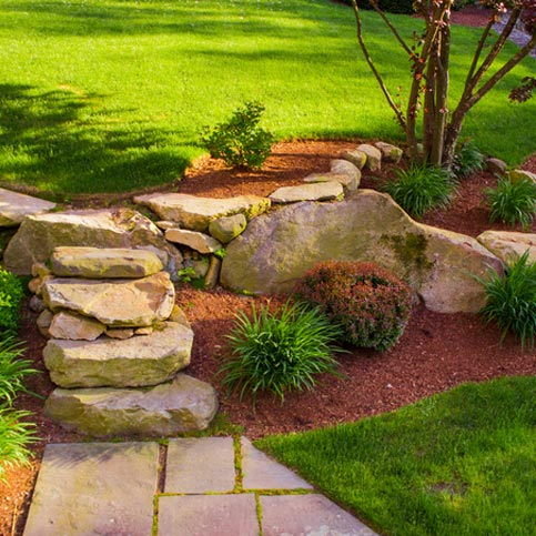 A beautiful landscaped garden with rocks and plants