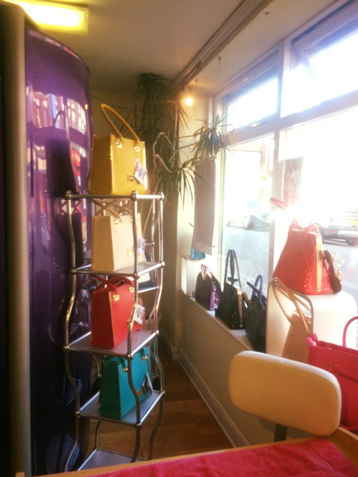 handbags hung on stand
