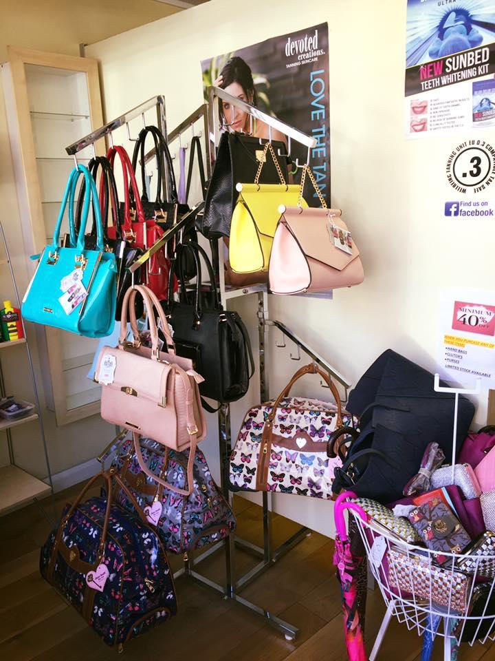 handbags on display in shop