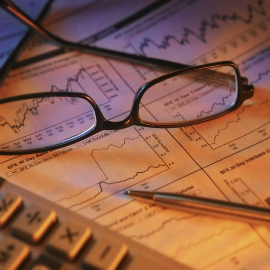 Pair of glasses on an accounting report representing accounting services in Milford, OH