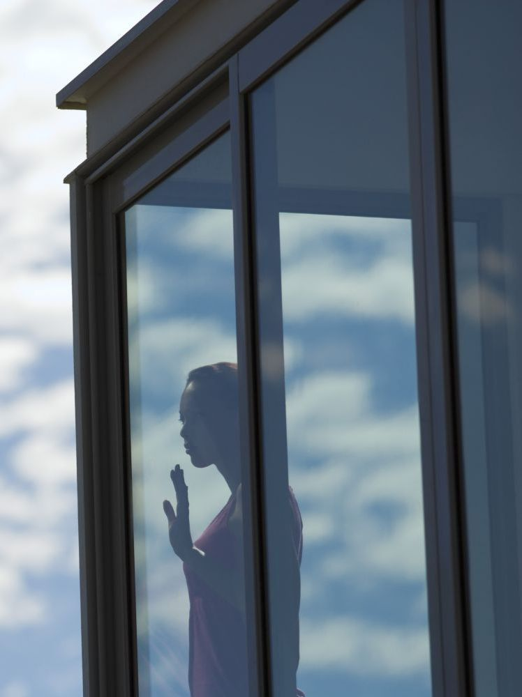 Woman looking through glass after window tinting in Northland