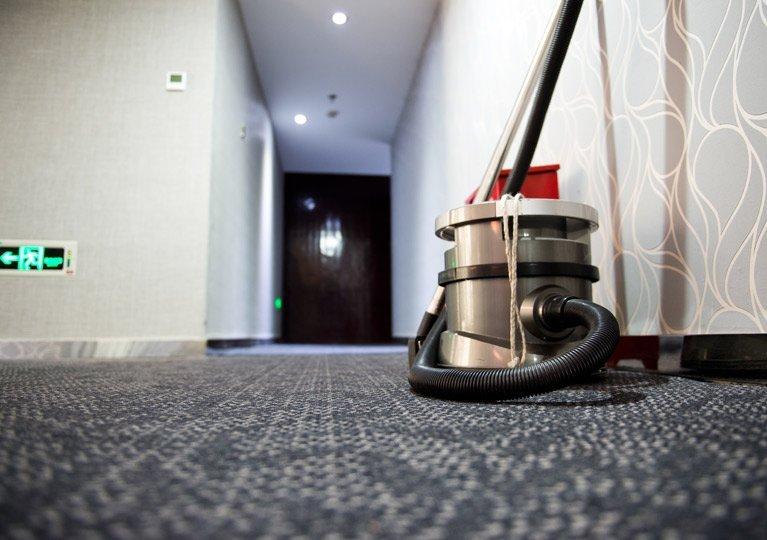 vacuum carpet hallway