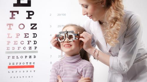 Kid during eye examination
