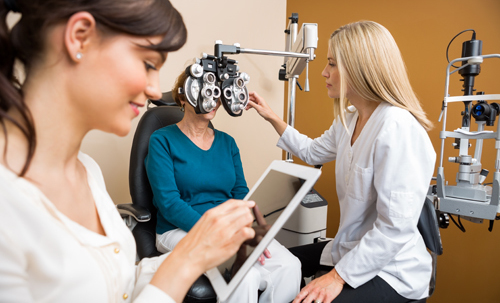 Optometrist testing the eye of patient