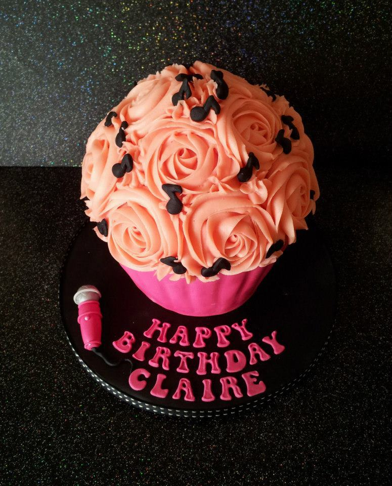 A giant peach cupcake with