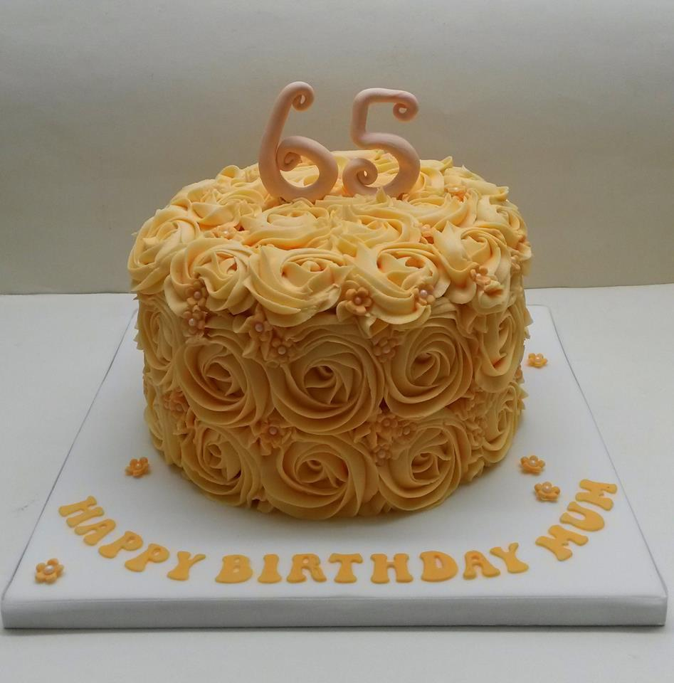 65th birthday cake decorated with peach roses