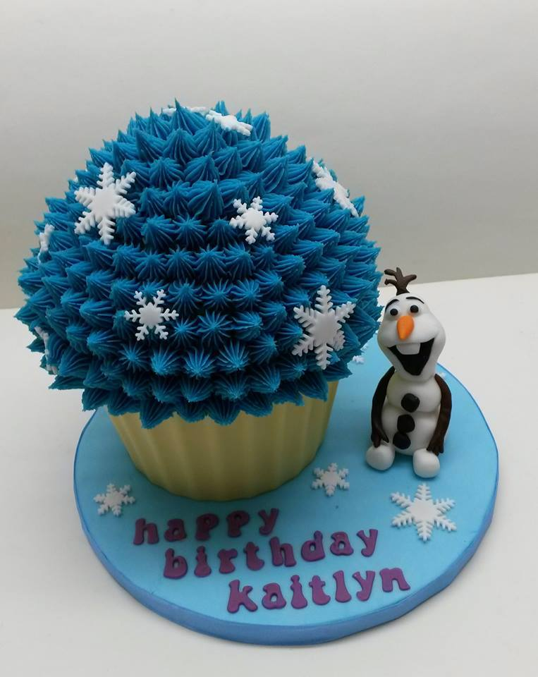 A giant blue cupcake decorated with silver starfish