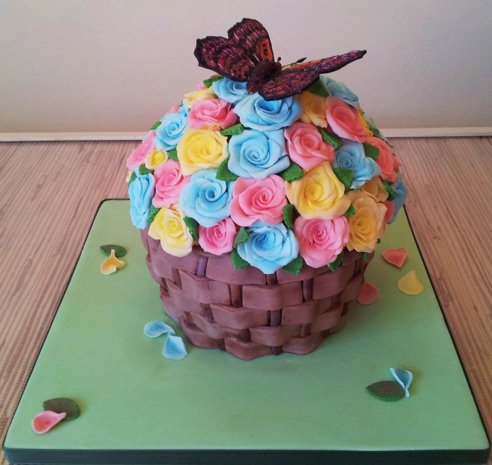 A basket-shaped case decorated with a butterfly on top of yellow, blue and pink flowers