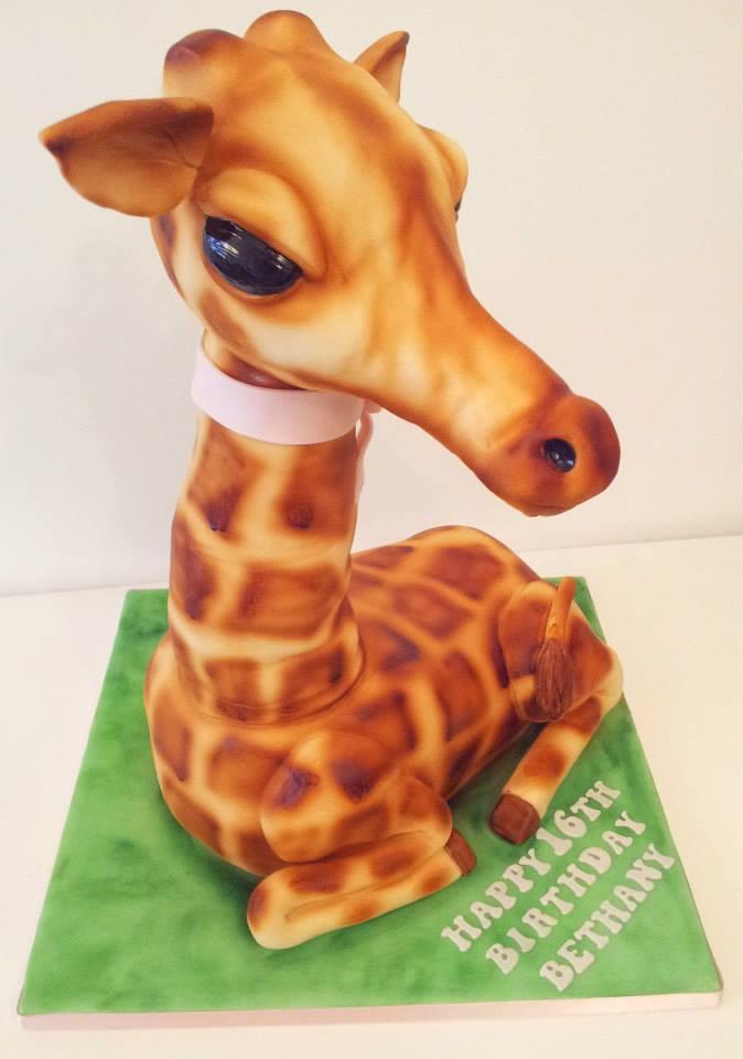 Giraffe shaped cake showing