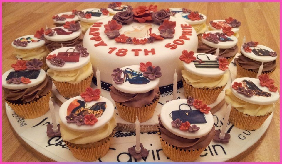 An 18th birthday cake with russet and brown roses, surrounded by cupcakes in the same style, decorated with shoes and bags