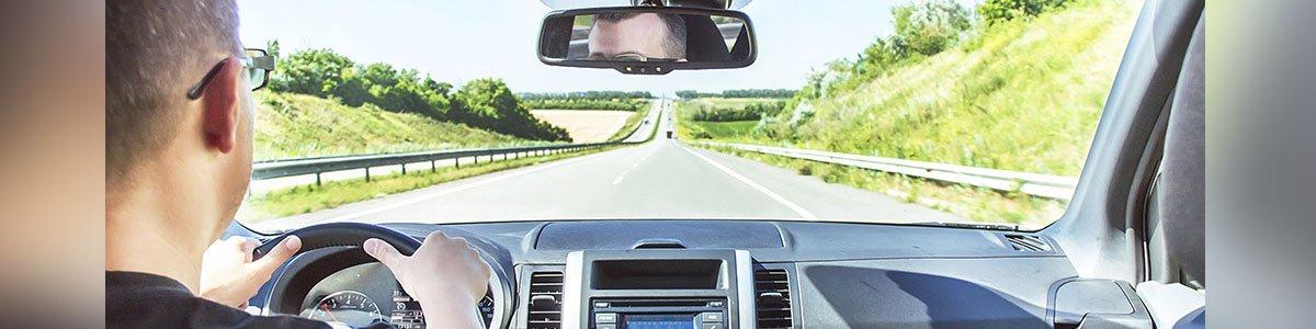 coastal discount windscreen man driving a car