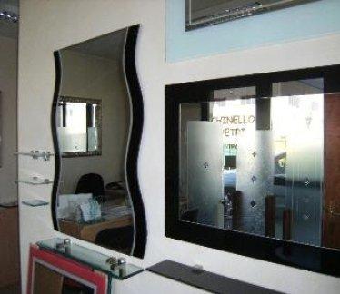Specchio ondulato con relativi attacchi