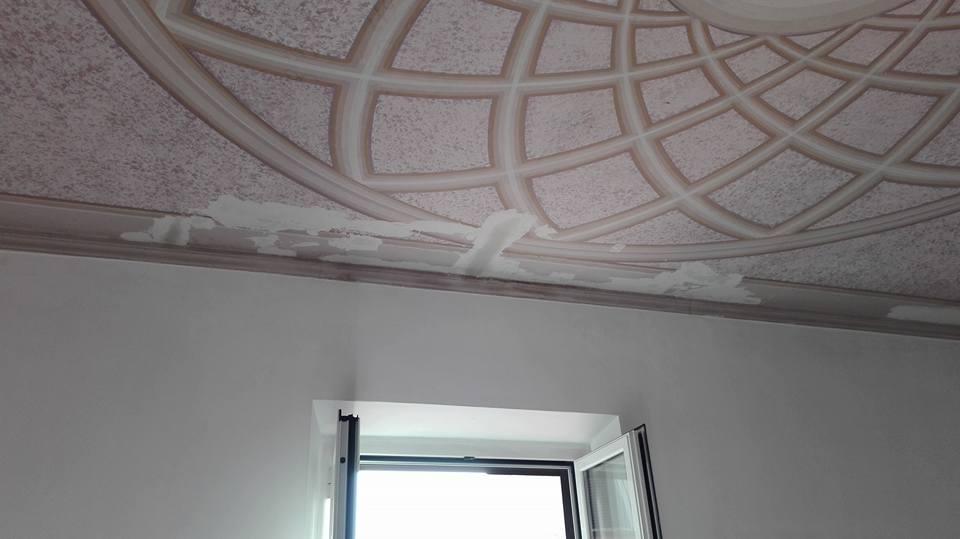 Restauro di un soffitto decorato