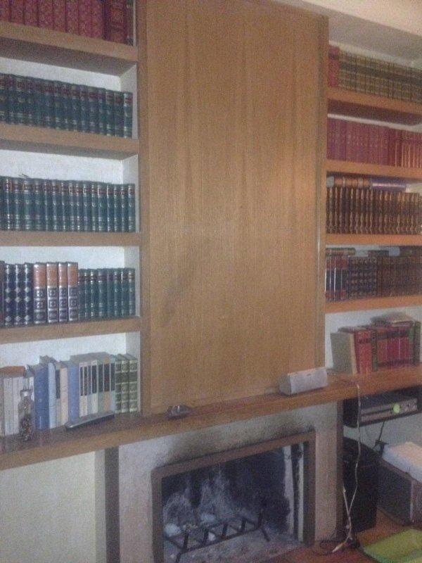 Restauro parete e libreria