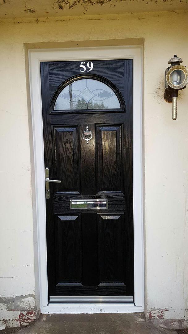 restored black wooden door - outside view