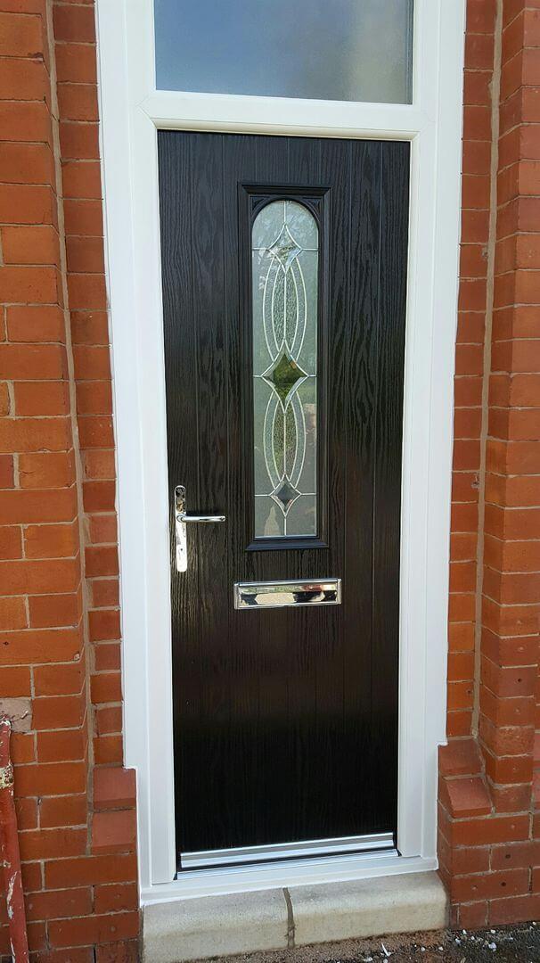 outside side view of dark wooden door