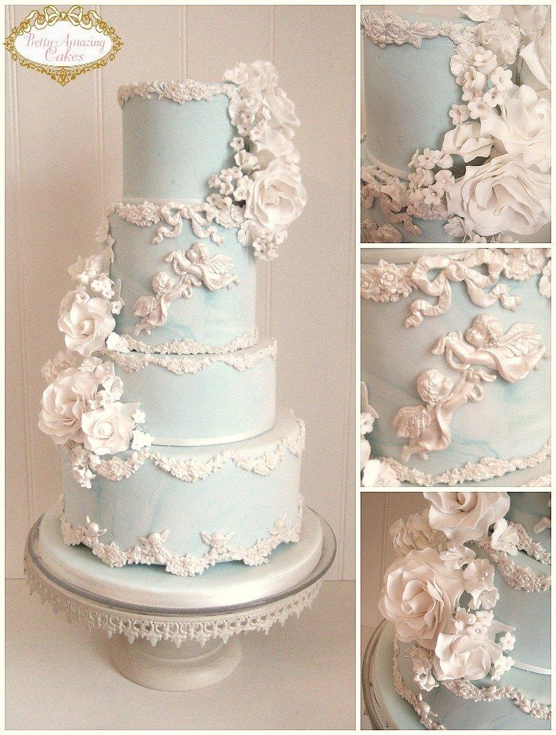 pastel blue wedding cake, wedding cakes with cherubs Bristol