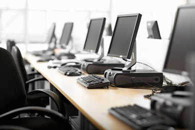 Row of computers in an office setting