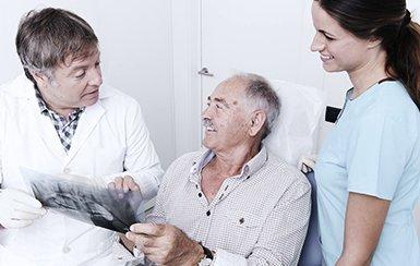 revesby dental centre dentist discussing with elderly gentleman