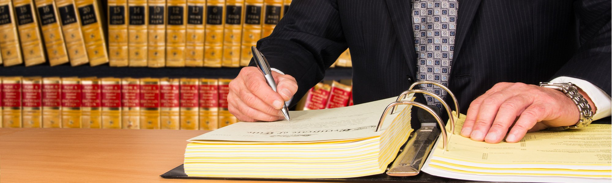 Lawyer entering details in the book