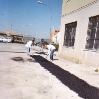 Lavori di ripristino di pavimentazione stradale