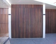 matching tilt doors clad with timber battens