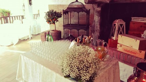 Spacious room and table full of glasses